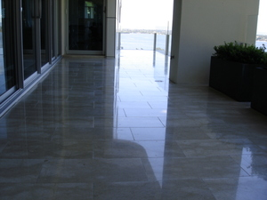 Limestone polishing, tiles polished & honed to original finish, grout cleaned - all sealed