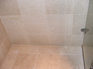 Limestone bathroom tiles cleaned, polished and sealed, silicone replaced