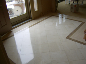 Marble tile cleaned, honed, polished & sealed