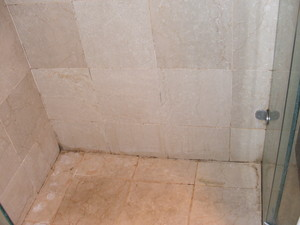 Limestone bathroom tiles stained, dull and dirty