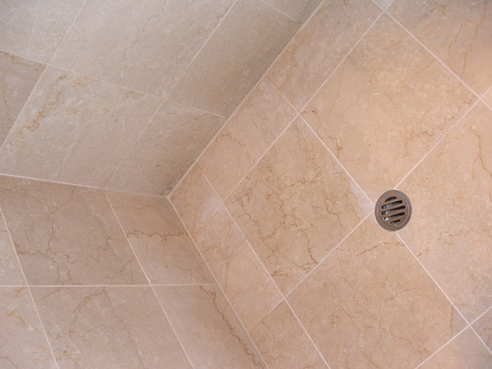Limestone bathroom tiles honed, polished and sealed, silicone replaced