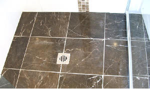 Emperador dark marble fully restored, silicone replaced and sealed