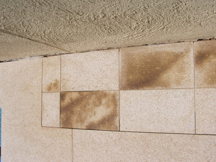 Poolside granite with iron oxide staining